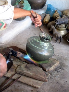 Blackening the pot