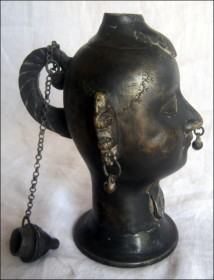 Lady head oil lamp (side view)
